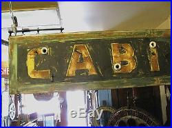 Vintage Tin Ex Neon Cabins Sign Folk Art Old Paint Shipping Available